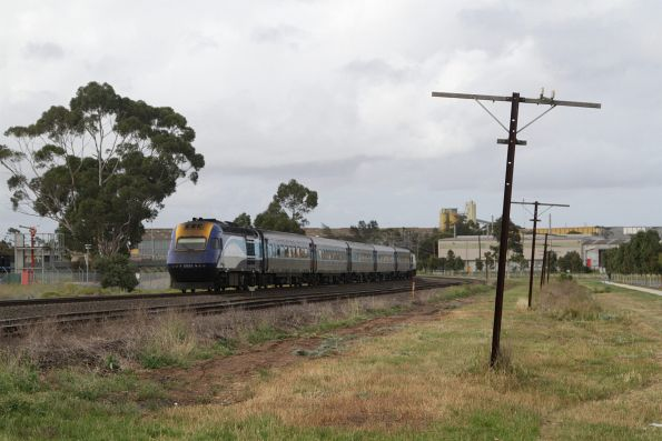 XP2001 trails a late running Melbourne-bound XPT through Albion