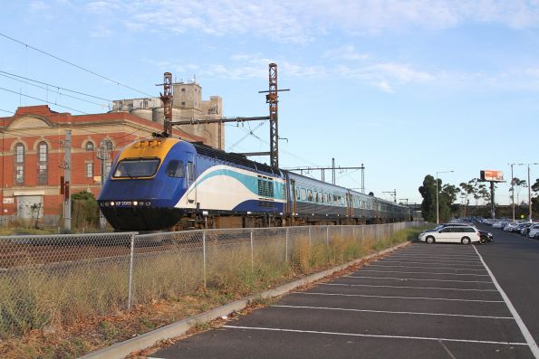 Southbound XPT led by XP2009 passes through Albion station