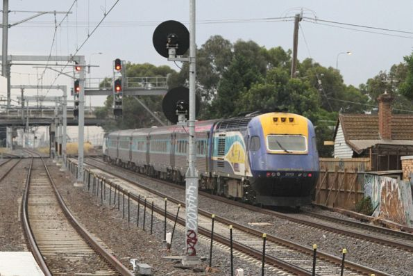 Northbound XPT passes through Middle Footscray, trailed by XP2013