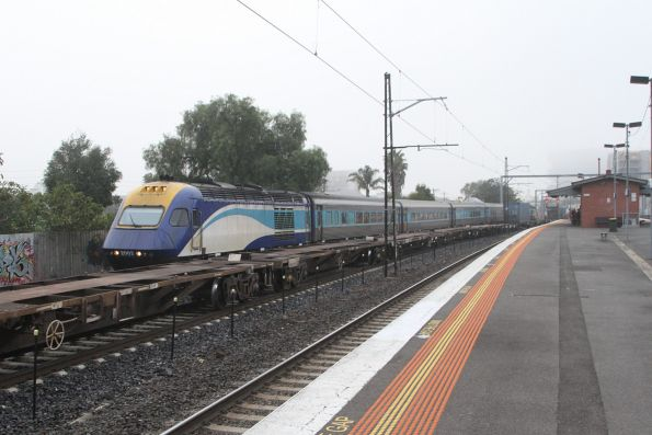 XP2002 leads the northbound XPT through Middle Footscray