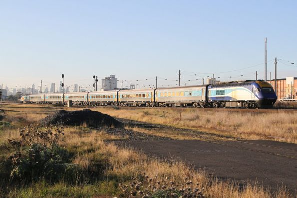 XP2010 leads Naidoc Week liveried XP2004 on the northbound XPT past Tottenham Yard