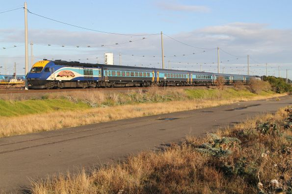 Naidoc Week liveried power car XP2004 trailing the northbound XPT past Tottenham Yard