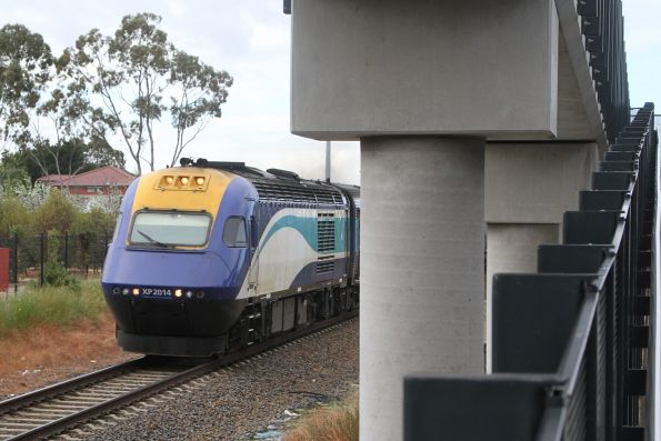 Northbound XPT passes Sunshine station with power car XP2014 in the lead