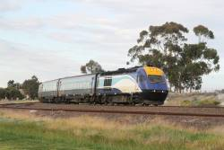 Southbound XPT led by XP2018 passes through Albion
