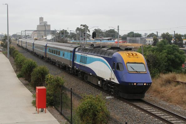 Northbound XPT led by power car XP2006 passes through Sunshine