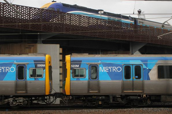 Northbound XPT passes over the North Melbourne flyover, Comeng train 599M and 522M below