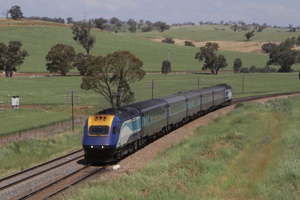 XP2001 leads the northbound Melbourne XPT out of Cootamundra at Jindalee