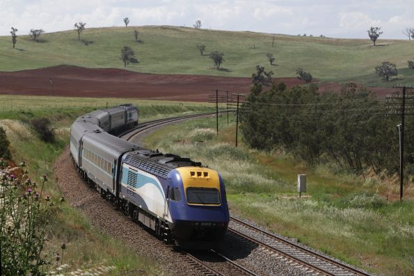 XP2002 trails the northbound Melbourne XPT out of Cootamundra at Jindalee
