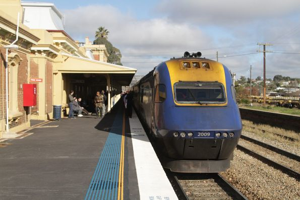 Northbound XPT led by XP2009 pauses for passengers at Junee