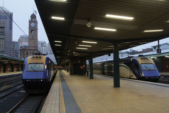 XPT sets led by XP2018 and XP2002 awaiting departure from Sydney Central
