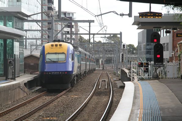 XP2014 trails a westbound XPT through Burwood station