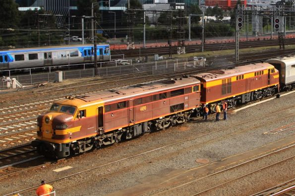 Crew cutting 4490 and 4306 off from the carriages outside Southern Cross