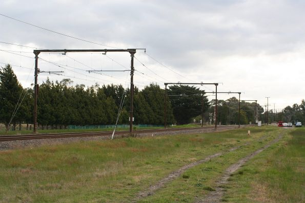 1950s era portal structures supporting the overhead on the Gippsland line at Beaconsfield