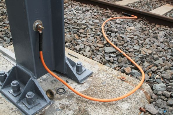 Fresh looking grounding jumper between stanchion and running rails