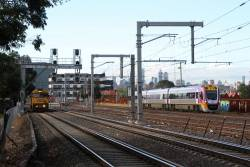 G527, P20 and G536 wait for a signal at West Footscray Junction, as VLocity VL73 speeds past