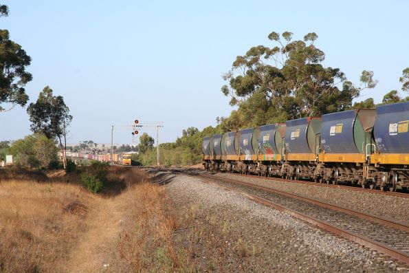 Tail end of the Apex train at Lara, as the Patricks train on the standard gauge closes in