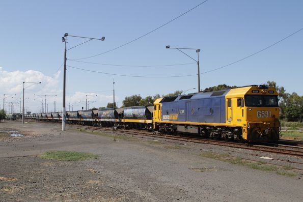 G531 shunts the quarry hoppers out of the maintenance workshops at North Geelong Yard