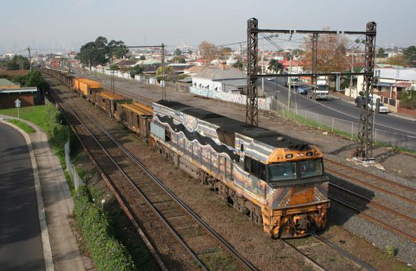 Indigenous liveried NR30 on a down steel train at West Footscray