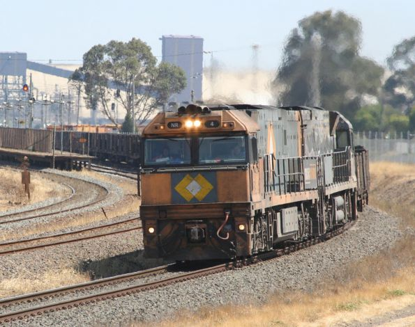 NR4 and indigenous liveried NR30 on an up steel train at North Shore