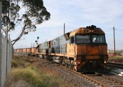 NR16 and NR118 Adelaide bound with a load of steel wagons at North Shore
