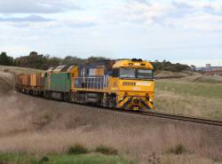 NR1 leads AN11 on a westbound steel train at Moorabool