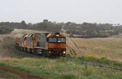 NR24 leads DL42 and BL31 on a westbound steel train at Moorabool