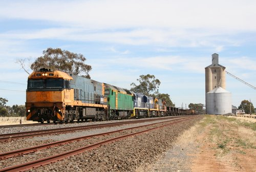NR47 leads AN9, NSW coal fields loco 8229, NR73, and NR107 on an eastbound steel train through Lubeck