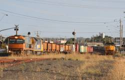 NR108 leads Pacific National liveried AN5 past XR558 and XR554 at North Geelong C