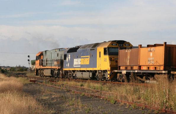 NR108 leads Pacific National liveried AN5 on a westbound steel train through North Geelong C