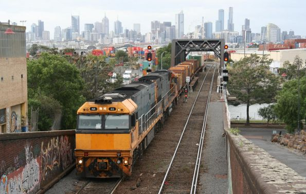 NR40 and NR88 depart Dynon with a westbound steel train