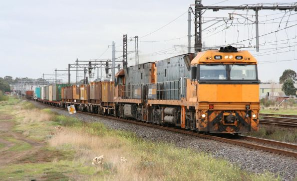 NR40 and NR88 lead a westbound steel train at Altona Junction
