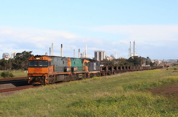 NR82, NR54 and 8122 pass through Corio, this time into the sun