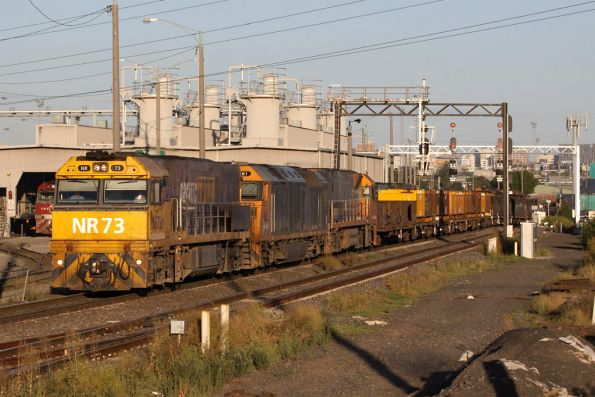 NR73 leads AN1 and NR117 on a northbound steel train at Sims Street Junction