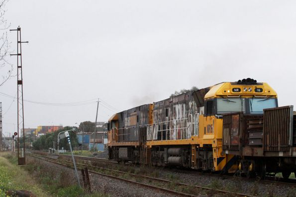 Up steel train with NR45 in PN livery, NR16 with stickers promoting level crossing safety