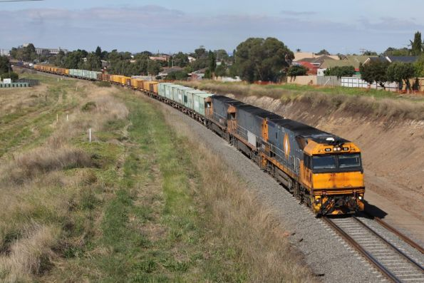 NR80, NR104 and NR7 lead westbound WP2 steel train towards the Ring Road at Bell Post Hill