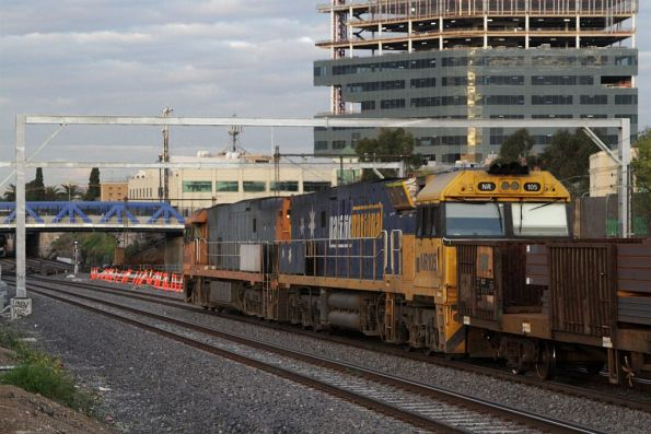 NR118 and NR105 lead the up steel train along the goods lines at Footscray