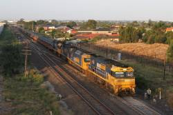 NR38 leads AN6, 9302 and 9301 on an up steel train at Keilor Park Drive, Keilor