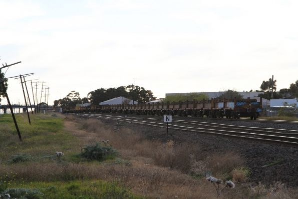 Plenty of empty coil steel wagons at the rear of MW2 steel train at Albion