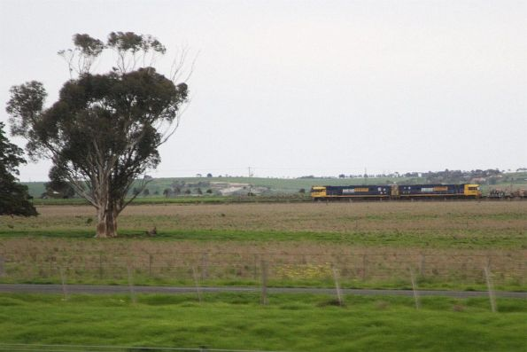 Pair of NR class lead a westbound steel train through Elders Loop