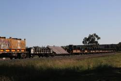 Tilt sheet steel and RKJX slab steel wagons between the coil steel and butterbox wagons