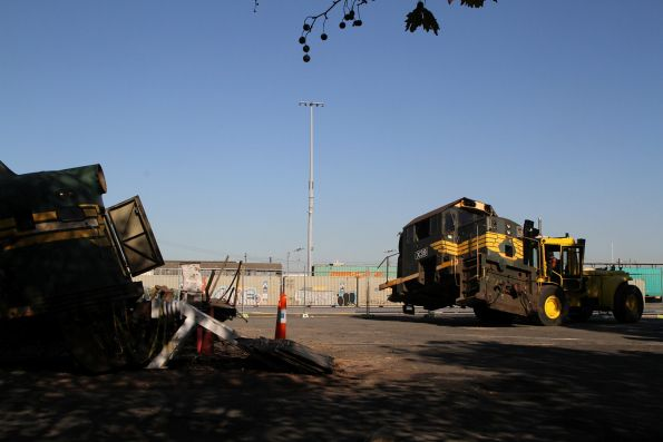 Forklift moves the cab of locomotive X39 for removal