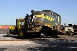 Forklift moves the cab of locomotive A79 for removal