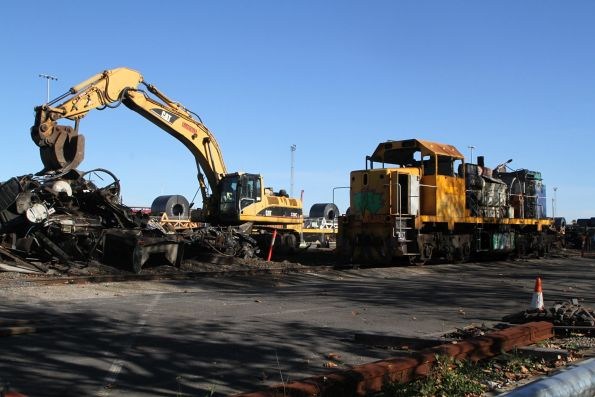 Excavator paused during the scrapping of T400