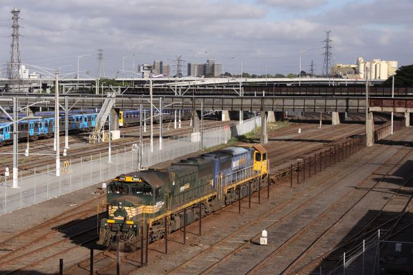 XR552 and XR557 await departure from Melbourne Yard with a rake of empty container flats