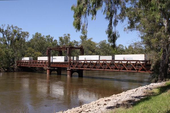 Containers roll over the Murray River bridge into Tocumwal
