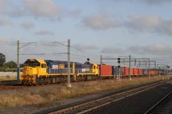 XR557 and XR553 leads the down Tocumwal freight onto the suburban tracks at Sunshine