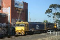 G522 and XR557 leads the down Tocumwal freight past Tottenham Yard