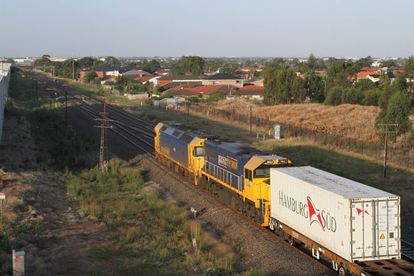 G536 and XR557 lead the down Tocumwal freight away from the Maribyrnong River bridge at Keilor Park Drive