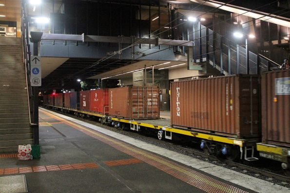 Loaded containers wagons roll through Sunshine on the up Tocumwal freight
