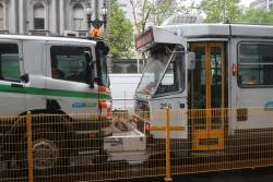 Recovery truck R10 gives tram A1.254 at push south down at William and Little Lonsdale Street